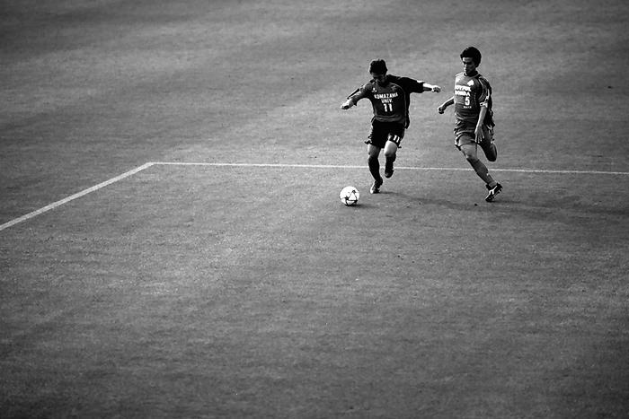 A Ball And Two Men On The Pitch (Tokyo)