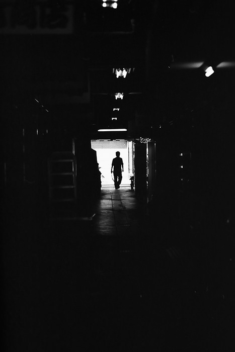 figure in the dark passageway