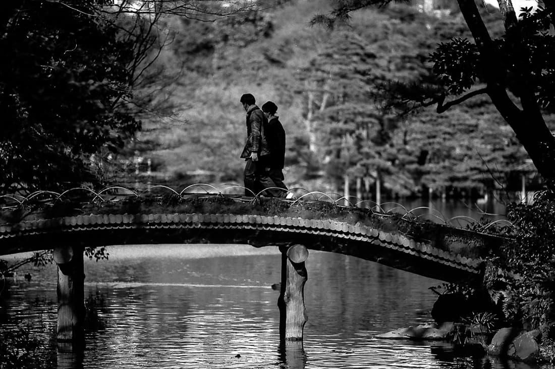 Couple crossing bridge
