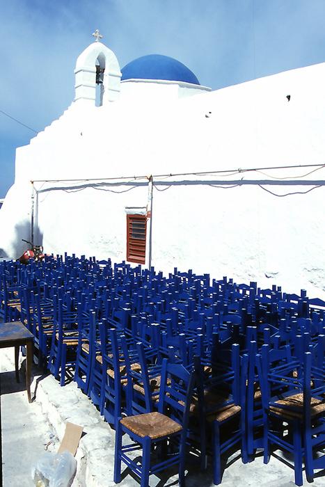 Blue chairs and white church