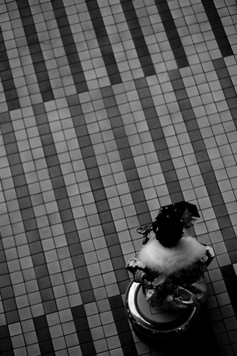 Youg Woman Wearing Kimono Was Sitting (Tokyo)