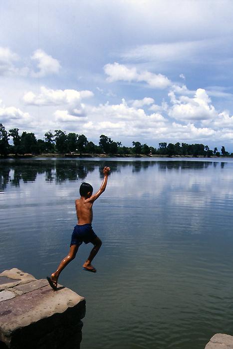 Boy jumping into Srah Srang