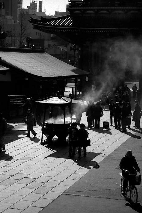 Smoke rising from incense burner