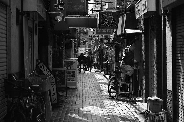 Shuttered shops in lane