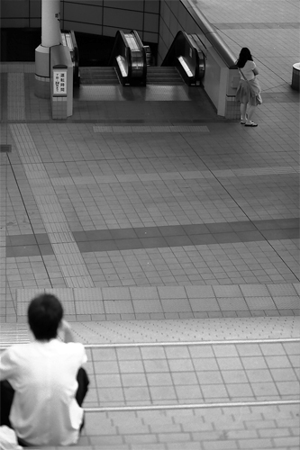 Boy On The Starway And Woman Beside The Escalator @ Tokyo