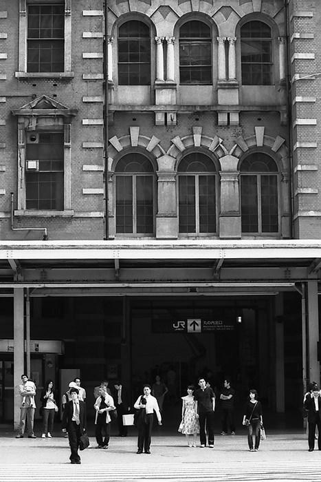 Businessmen at pedestrian crossing