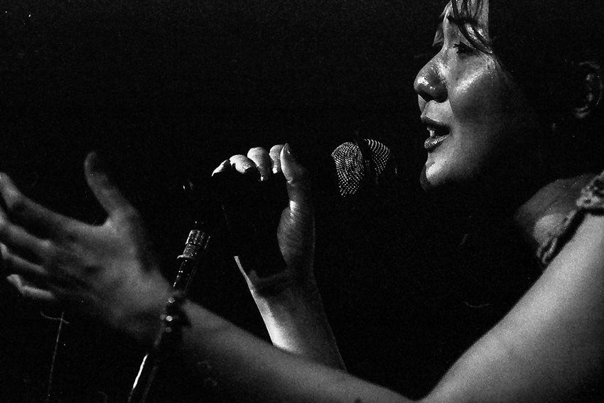 Woman singing from the heart