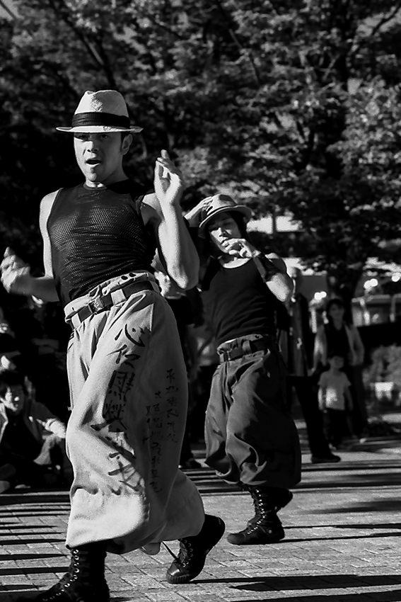 Hatted men dancing
