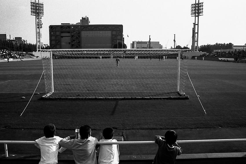Boys behind goal post