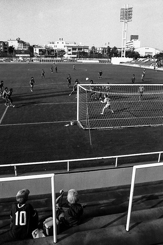 Boys behind goal posts