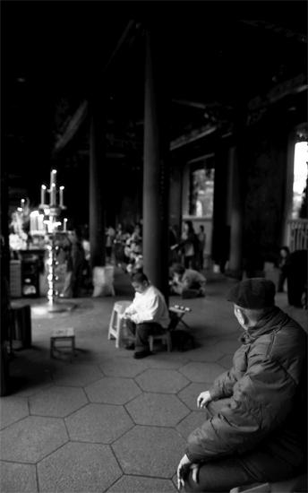 Old Man Sitting In Longshan Temple (Taiwan)