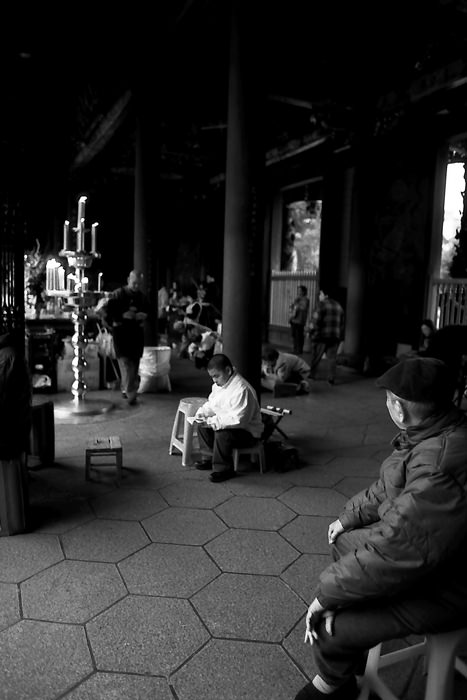 Old Man Sitting In Longshan Temple (Taiwan)