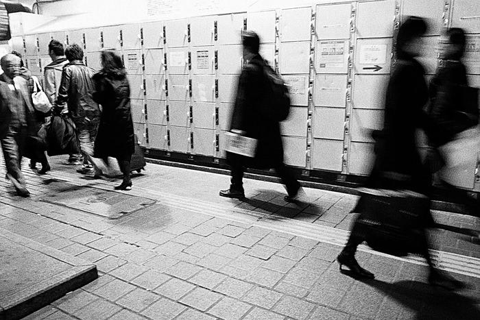 Pedestrians in front of lockers