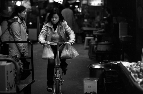 Woman Riding With Two Plastic Bags (Taiwan)