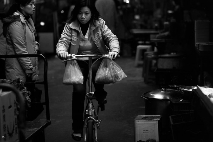 Woman pedaling bicycle