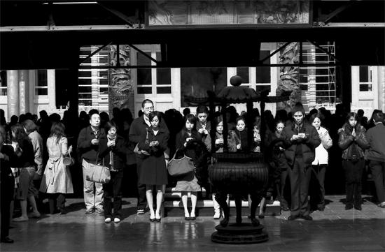 Worshipers Praying Together In Hsing Tian Kong (Taiwan)