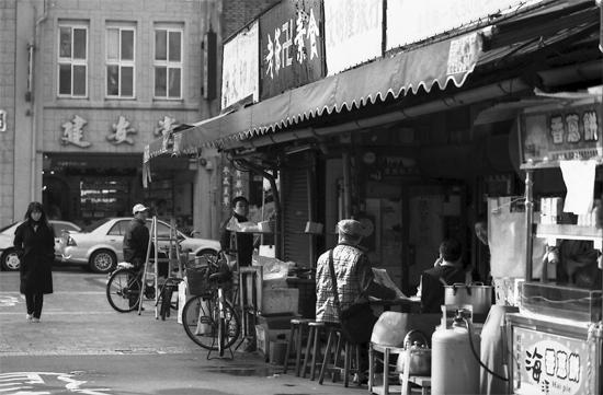 Young Woman Walking The Street (Taiwan)