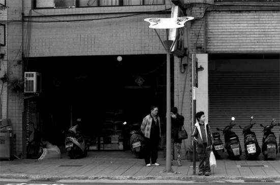 Boy Waiting At A Bus Stop @ Taiwan