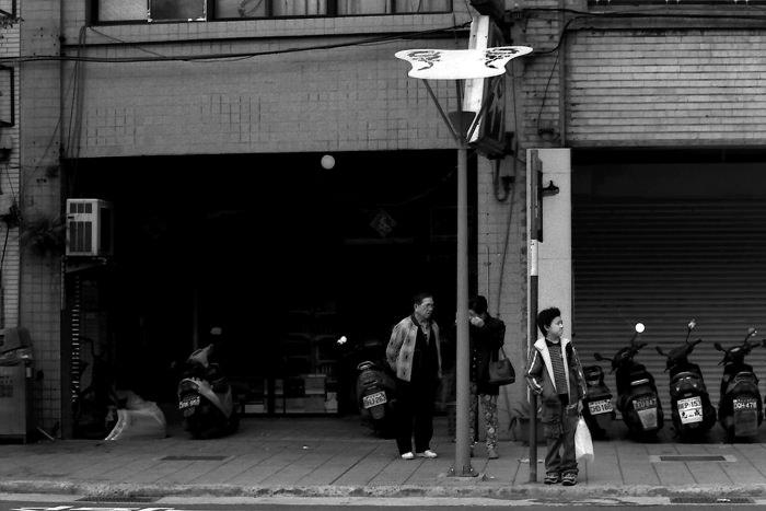 Boy Waiting At A Bus Stop (Taiwan)