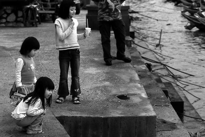 Girls playing on riverside