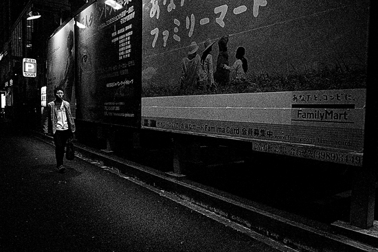 Man Walking Beside Big Signboards (Tokyo)