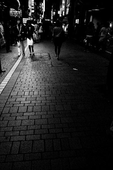 Pedestrians In The Dark Street (Tokyo)