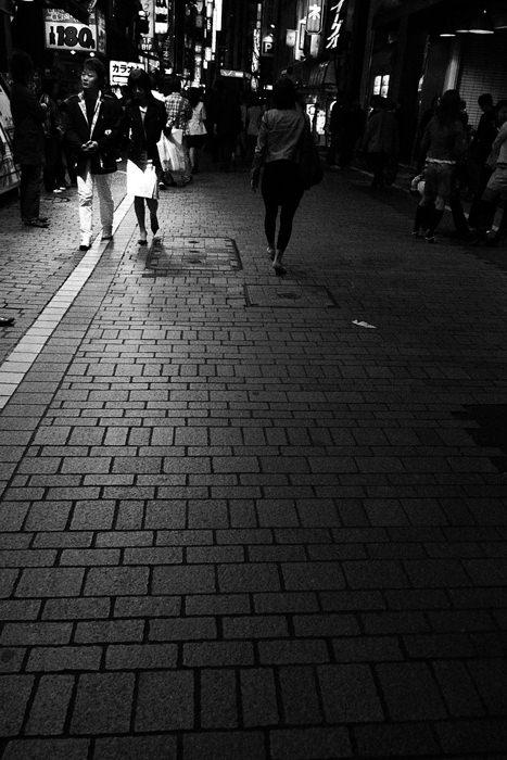 Pedestrians walking at night