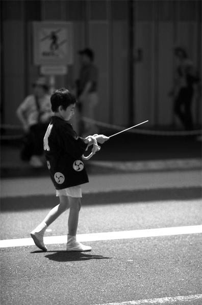 Boy Walking With A Pole @ Tokyo