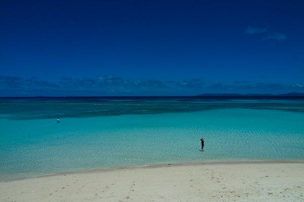 Figure Standing In The Blue Ocean In Hateruma (Okinawa)