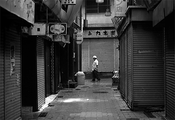 Man Walking The One-time Busy Street @ Okinawa