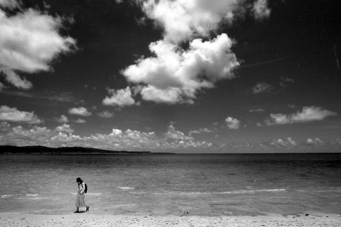 Woman walking shore