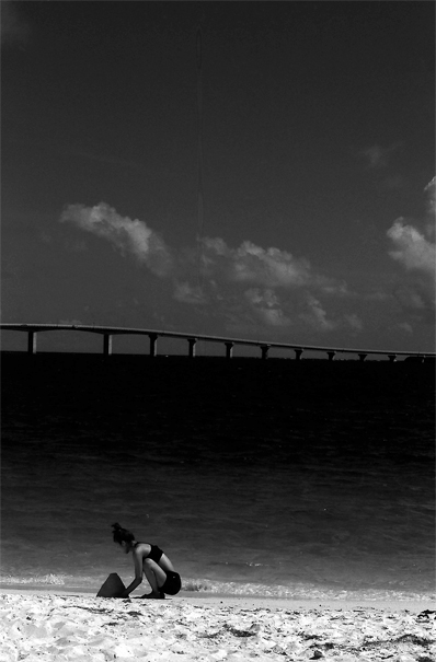 Girl Playing With Sand And A Bridge (Okinawa)