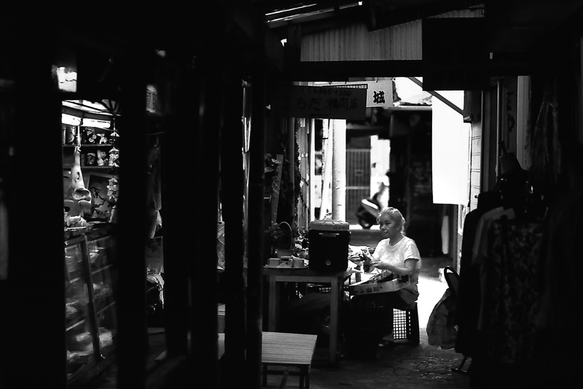 Woman sitting in storefront