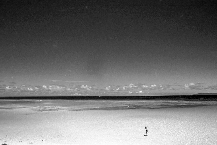 Lonely figure in shallow water