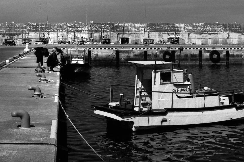 Two boys fishing in Sarahama harbor