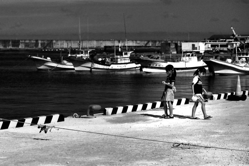 two girls playing in harbor in the isle of Irabu