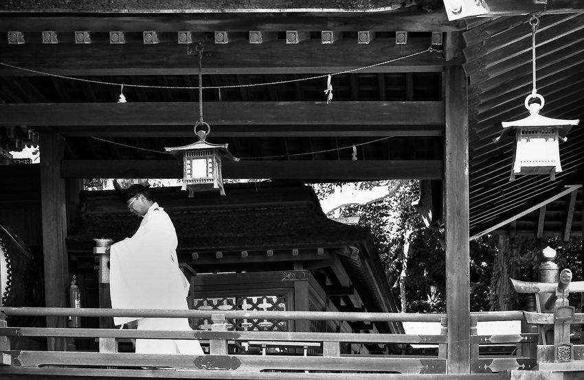 Shinto priest walking corridor