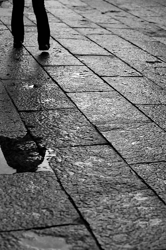 Figure in puddle