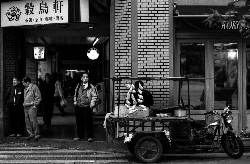 Man standing in corner of street