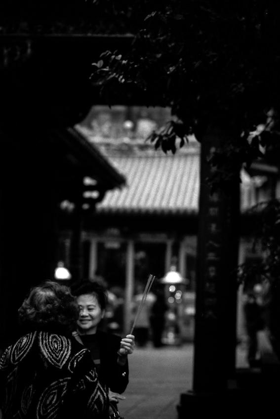 Two women standing talking in Longshan Temple