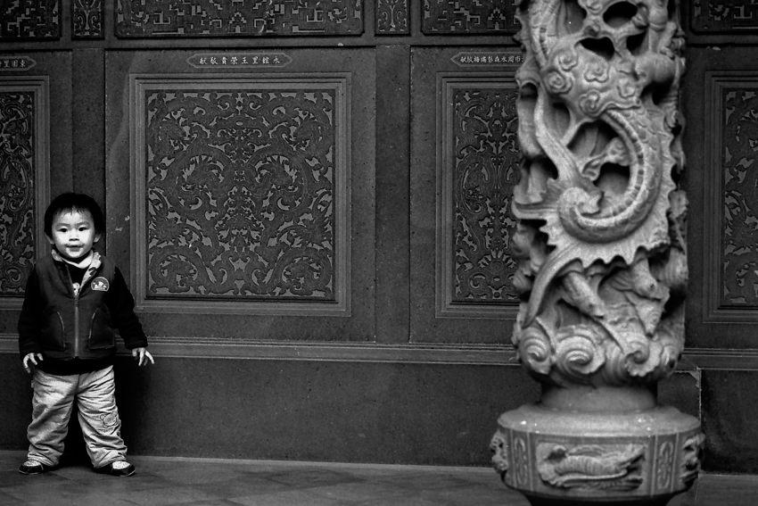 Boy beside pillar in Tzushr Temple
