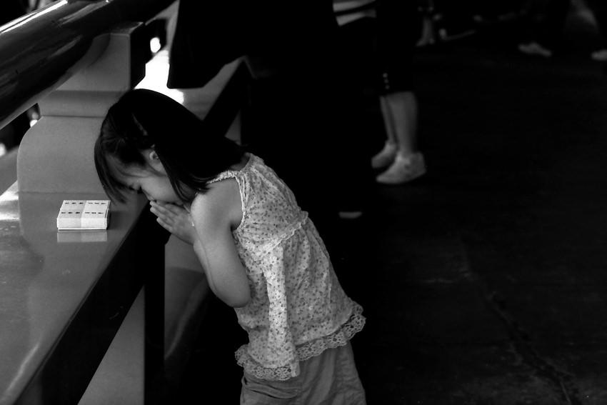 Girl praying in Senso-Ji
