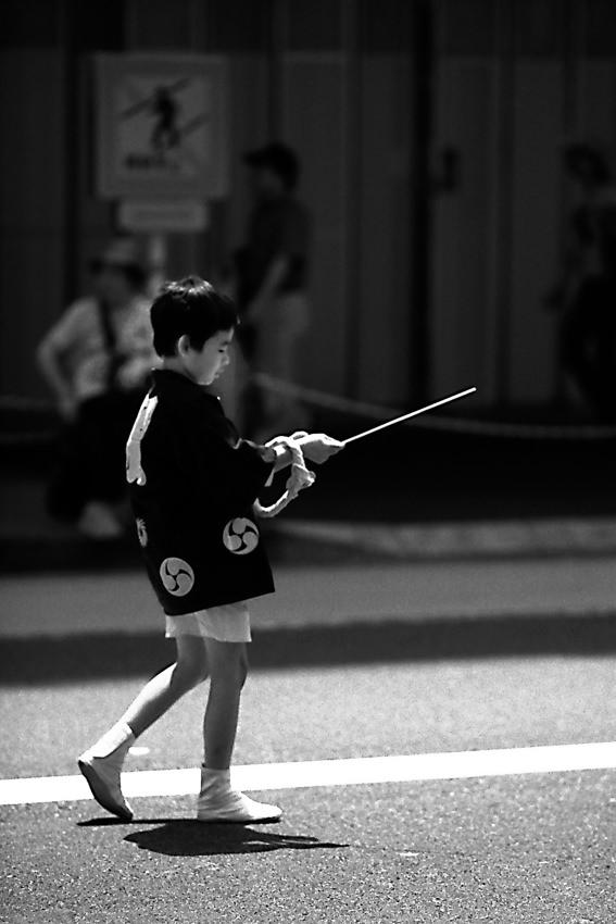 Boy having pole