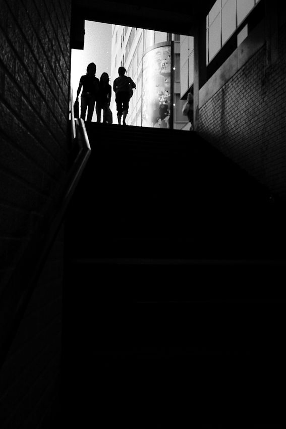 Silhouettes on top of stairway