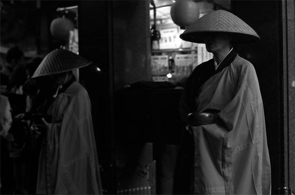 Two Monks Standing At The Gate Of Kogan-ji (Tokyo)