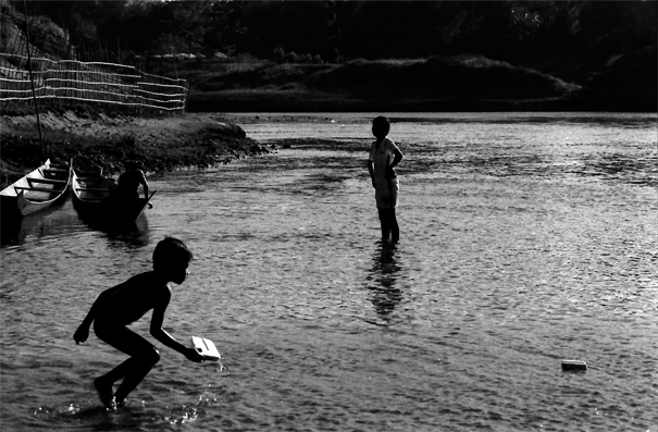 Silhouettes In The Nam Khan River (Laos)