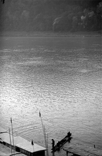 Boat approaching riverbank of Mekong