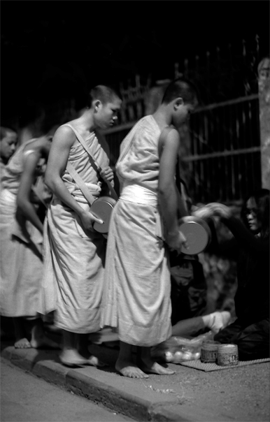 Monks receiving charity