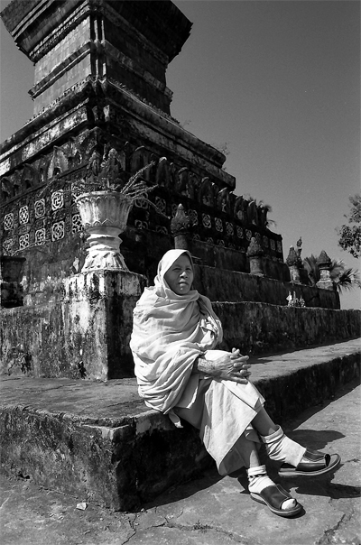 Buddhist monk sitting with feet crossed