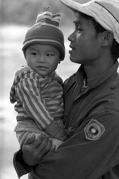 Baby Held By The Father (Laos)